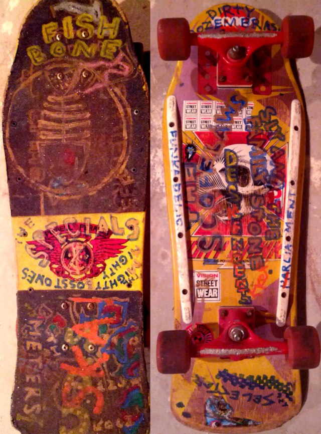 A Tony Hawk screaming chicken skull bottle-nose deck from 1989 with Tracker trucks and Slimeball wheels.   This skateboard was owned by Bob Phair of The Preschoolers. In the early 90's Phair decorated the board with graffitti that reflected the musical diversity of Towson-Glen Arm; the band names from top-to-bottom/left-to-right: (on the top deck at left) Fishbone, The Specials, The Mighty Mighty Bosstones, The Meters, U.D.S. (Urban Dance Squad); (on the bottom deck) Dirty Dozen Brass Band, Funkadelic, The Scofflaws, Descendants, Sly and The Family Stone, Parliament, The Selecter (courtesy of Bob Phair)