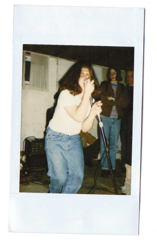 Lisa Starace roarin' the roof off at a Within show; Cesar's House - Annapolis, Md. suburbs; April 30th 1994 (photo by Melissa Fatto)