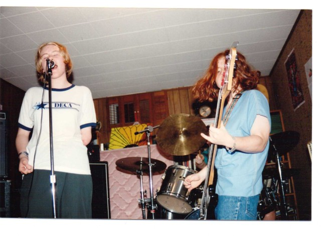 (left to right) Tricia Lane-Forster and Lisa Starace performing live with Spastic Cracker in Lutherville-Timonium, Md. at Matt Bray's basement; June 1994; photo by Lee Versoza